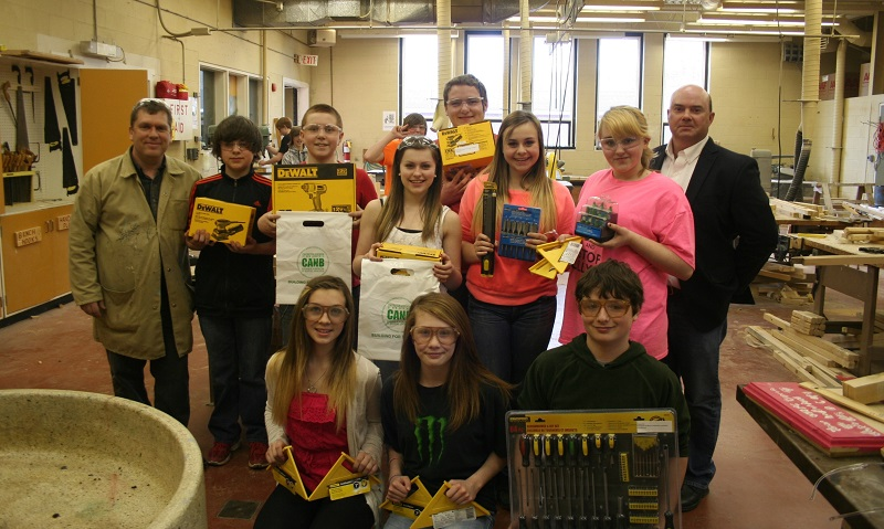 Darren Webber (back right) of the Fredericton Northwest Construction  Association presented Nackawic Middle with their wish list for the Shop  Class.